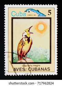 MOSCOW, RUSSIA - AUGUST 29, 2017: A stamp printed in Cuba shows Eastern Meadowlark (Sturnella magna), Endemic birds, circa 1983
