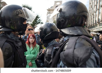 Moscow, Russia - August 3, 2019 Russian police in protective gear opposes the demonstrators during opposition protests
