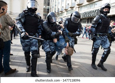 Moscow, Russia - August 3, 2019 Riot police officers detain a participant of an unsanctioned rally urging fair elections at Pushkinskaya Square