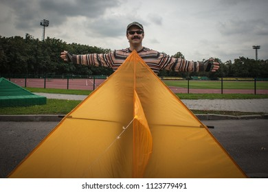 MOSCOW, RUSSIA - AUGUST 30, 2013: The man launches an air kite.
