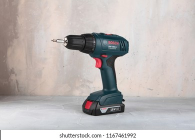 MOSCOW, RUSSIA, AUGUST 30, 2018. 18V Lithium-Ion Cordless Drill/Drivers Bosch GSR 1800-LI against the background of a plastered wall.