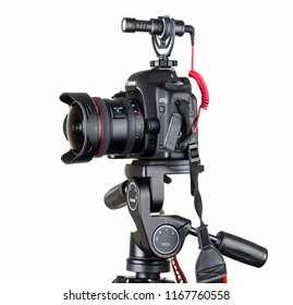 Moscow, Russia - August 30, 2018: Canon EOS 5D Mark III, SLR camera with Canon EF 8-15mm f / 4.0L Fisheye USM lens, Rode external directional microphone, on Benro tripod, with HD3 head, editorial.