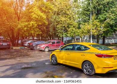 MOSCOW, RUSSIA - AUGUST  31, 2018: Yellow taxi stands in the courtyard of a residential building in Moscow