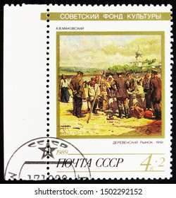 MOSCOW, RUSSIA - AUGUST 31, 2019: Postage stamp printed in Soviet Union (Russia) shows Village Market by A.V. Makovsky, 1919, Soviet Culture Fund, serie, circa 1989
