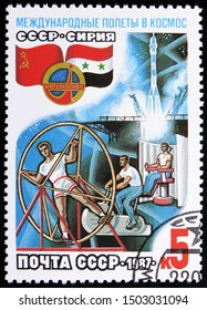 MOSCOW, RUSSIA - AUGUST 31, 2019: Postage stamp printed in Soviet Union (Russia) shows Cosmonauts training on the background of starting spacecraft, Soviet-Syrian Space Flight serie, circa 1987