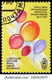 MOSCOW, RUSSIA - AUGUST 31, 2019: Postage stamp printed in Soviet Union (Russia) shows Balloons, Pictures by Soviet Children, Lenin Soviet Children's Fund serie, circa 1990
