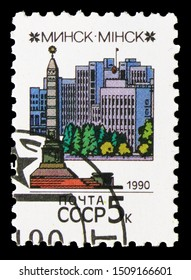 MOSCOW, RUSSIA - AUGUST 31, 2019: Postage stamp printed in Soviet Union (Russia) shows Government palace and Liberation monument (Minsk), Capitals of Soviet Republics serie, circa 1990