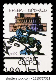 MOSCOW, RUSSIA - AUGUST 31, 2019: Postage stamp printed in Soviet Union (Russia) shows David of Sassoun Monument and Opera and Ballet Theatre, Capitals of Soviet Republics serie, circa 1990
