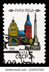 """MOSCOW, RUSSIA - AUGUST 31, 2019: Postage stamp printed in Soviet Union (Russia) shows Freedom monument, Dumskaya church and """"Three Brothers"""", Capitals of Soviet Republics serie, circa 1990"""
