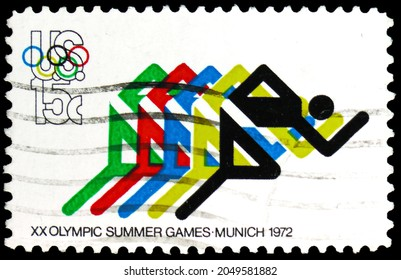 MOSCOW, RUSSIA - AUGUST 5, 2021: Postage stamp printed in USA shows Running and Olympic Rings, Olympic Games 1972 - Munich and Sapporo serie, circa 1972