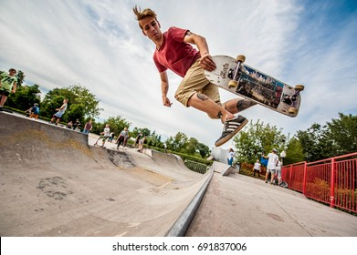 Moscow, Russia - August 8, 2017: Young skateboarder is doing skating tricks at the Gorky park