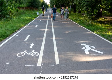 Moscow, Russia - August 8, 2018. Asphalt path in a park with markings for pedestrians and bicycles