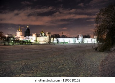 MOSCOW, RUSSIA - Beautiful nightscape of the architectural ensemble of Novodevichy convent from a frozen and covered snow Bolshoy (Big) Pond at winter night.
