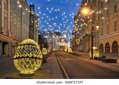 MOSCOW, RUSSIA -Beautiful outdoor decorations in form of Easter eggs illuminated with LED lights on Bolshaya Dmitrovka street taken in twilight on early Sunday morning, the last day of Orthodox Easter