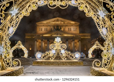 MOSCOW, RUSSIA - Bolshoi Theater Framed by New Year Decorations with Lens Flare in early morning during a heavy snowfall.
