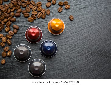 MOSCOW, RUSSIA - OCTOBER29, 2019:Nespresso Capsules and Coffee Beanson Grey Black Background Top ViewNatural Light Selective Focus Nespresso is Worldwide Company of Coffee Products