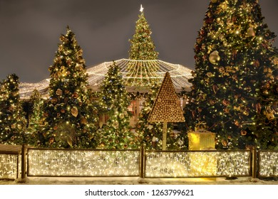 MOSCOW, RUSSIA - Christmas Trees with Canopy of Lights at Manezhnaya Square at Night. Festive New Year decorations in Moscow before upcoming winter hlidays.