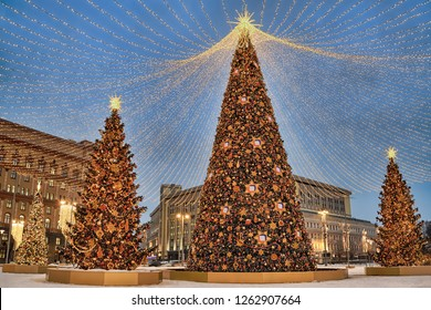 MOSCOW, RUSSIA - Christmas Trees Under Canopy of Lights at Lubyanka square in Twilight. New Year decorations to upcoming winter hlidays.