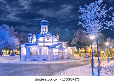 Moscow. Russia. Church on a winter evening. A small Church against a dark sky and snow-covered trees. Churches of Russia. Orthodoxy. Christmas eve. New year in the capital of Russia. Travel to Moscow