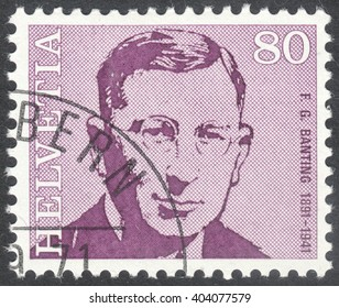 """MOSCOW, RUSSIA - CIRCA APRIL, 2016: a post stamp printed in SWITZERLAND  shows a portrait of Frederick Banting, the series """"Doctors"""", circa 1971"""
