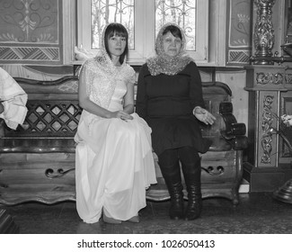 MOSCOW, RUSSIA - CIRCA APRIL, 2017: Temple of Zosima & Savvaty in Golyanovo. The rite of the Orthodox wedding. The bride and witness before wedding.