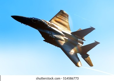 MOSCOW, RUSSIA - CIRCA AUGUST, 2011: US Air Force 48th Fighter Wing McDonnell Douglas Boeing F-15 Strike Eagle military combat fighter bomber jet warbird aircraft flying silhouette