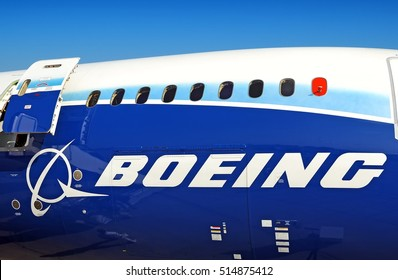 MOSCOW, RUSSIA - CIRCA AUGUST, 2011: Boeing Company passenger airplane Boeing B 787 Dreamliner fuselage side close up with open exit door passenger windows cargo door Boeing logo close up view