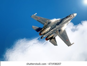 MOSCOW, RUSSIA - CIRCA AUGUST, 2013: Russian Air Force twin jet engine Su-35 Flanker fighter bomber jet aircraft performing aerobatic maneuver using afterburner with huge jet blast aerial detail view