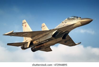 MOSCOW, RUSSIA - CIRCA AUGUST, 2013: Twin engine Sukhoi Su-30 Flanker fighter bomber war plane flying aerial detail exterior sunset view