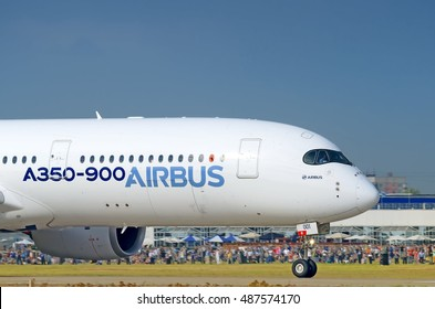 MOSCOW, RUSSIA - CIRCA AUGUST, 2015: Airbus Industrie Airbus A350 XBW modern widebody long range twin jet engine passenger airplane in airbus corporate colors take off nose crop exterior detail view