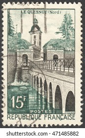 "MOSCOW, RUSSIA - CIRCA AUGUST, 2016: a stamp printed in FRANCE shows the Le Quesnoy, castle and bridge, the series ""Landscapes"", circa 1957"