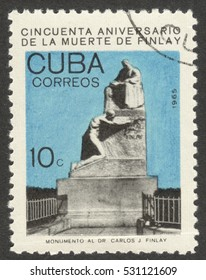 """MOSCOW, RUSSIA - CIRCA DECEMBER, 2016: a post stamp printed in CUBA shows a monument to C. Finlay, the series """"The 50th Anniversary of the Death of Carlos J. Finlay, Malaria Researcher"""", circa 1965"""