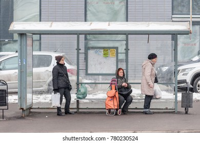 MOSCOW, RUSSIA - CIRCA DECEMBER, 2017: People are waiting for public transport at the bus stop. Yartsevskaya street.