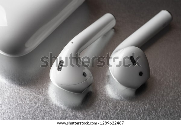 Moscow, Russia - Circa December 2018: Apple AirPods - wireless bluetooth earphones or headphones, use with Iphone, Ipad or Mac