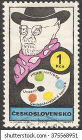 """MOSCOW, RUSSIA - CIRCA FEBRUARY, 2016: a post stamp printed in CZECHOSLOVAKIA shows a portrait of Henri Matisse, the series """"UNESCO - Cultural Personalities of the 20th Cent in Caricature"""", circa 1969"""