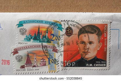 MOSCOW, RUSSIA - CIRCA JANUARY 2017: stamps printed by Russia showing traditional architecture and Pavel Silaev (1916-1942)