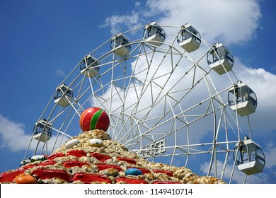 MOSCOW, RUSSIA - CIRCA JULY 2018 Big wheel and roof of building in Skazka park