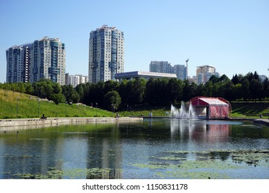 MOSCOW, RUSSIA - CIRCA JULY 2018 Apartment buildings and pond with fountain in Olimpic park