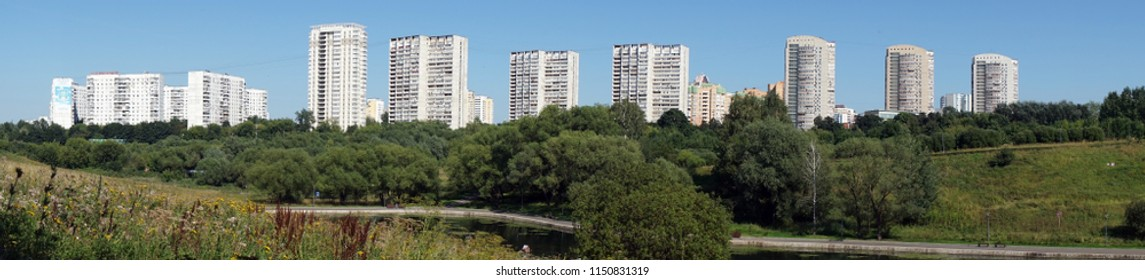 MOSCOW, RUSSIA - CIRCA JULY 2018 Apartment buildings and pond in Olimpic park
