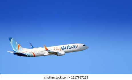 MOSCOW, RUSSIA - CIRCA JULY, 2018: FlyDubai airlines Boeing 737 800 modern passenger jet airplane flying against blue sky air travel business trip theme panoramic exterior background aerial view