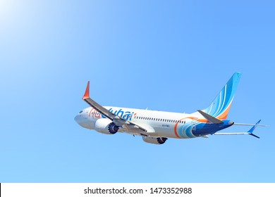 MOSCOW, RUSSIA - CIRCA JULY, 2018: Boeing 737max airplane of flydubai airlines flying isolated on blue sky background aerial side view of modern passenger jet B737max plane take off from airport