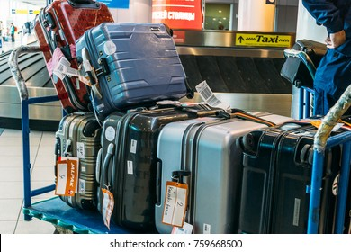 Moscow, Russia - Circa June 2017: Airport luggage Trolley with suitcases Domodedovo Airport in Moscow