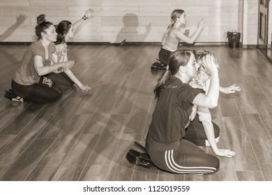 """MOSCOW, RUSSIA - CIRCA JUNE, 2018: Dance master class. Dance in shoes with heels. Dancers work out individual movements for the dance. Interior of the """"Gold & dance"""" studio."""