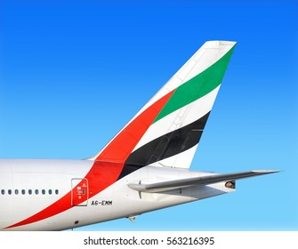 MOSCOW, RUSSIA - CIRCA MARCH, 2008: Emirates airlines Boeing company B777 widebody passenger airplane tail fin close up aerial view against blue sky aviation travel transportation background