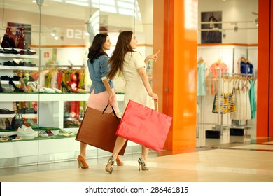 "MOSCOW, RUSSIA - CIRCA MAY 2015: Two young girls walk around the store with shopping bags in their hands at Shopping center ""Vegas"" in Moscow, Russia"