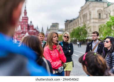 MOSCOW, RUSSIA Circa May 2015: a girl working as a tourist guide in moscow on a walking tour