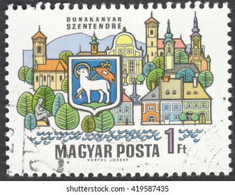 "MOSCOW, RUSSIA - CIRCA MAY, 2016: a post stamp printed in HUNGARY shows coat of arms and buildings of Szentendre, the series ""Towns of the Dunakanyar"", circa 1969"