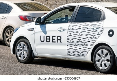 MOSCOW, RUSSIA - CIRCA MAY, 2017: Modern city taxi cab car with Uber online internet taxi transportation service side markings on street at Moscow city center close up background