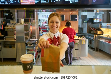 MOSCOW, RUSSIA - CIRCA MAY, 2018: worker at McDonald's. McDonald's is an American hamburger and fast food restaurant chain.