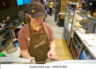 MOSCOW, RUSSIA - CIRCA MAY, 2018: worker at McCafe in Moscow